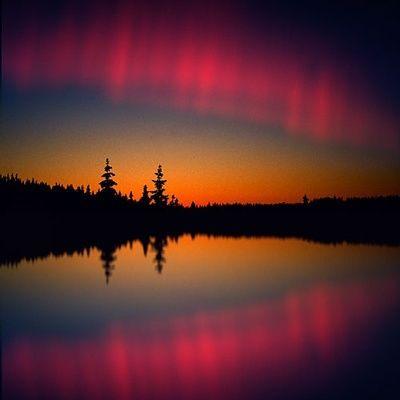 Aurora borealis over a lake in Lapland, Norway
