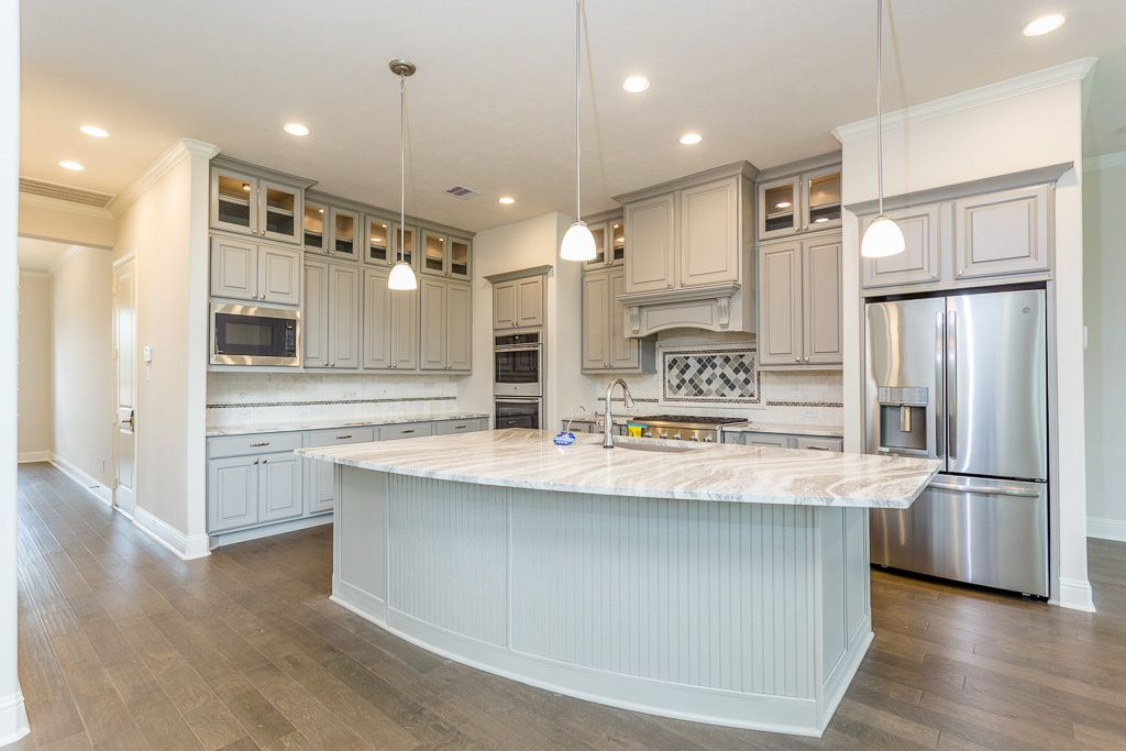 Extending the cabinets to the ceiling gives a custom look ...