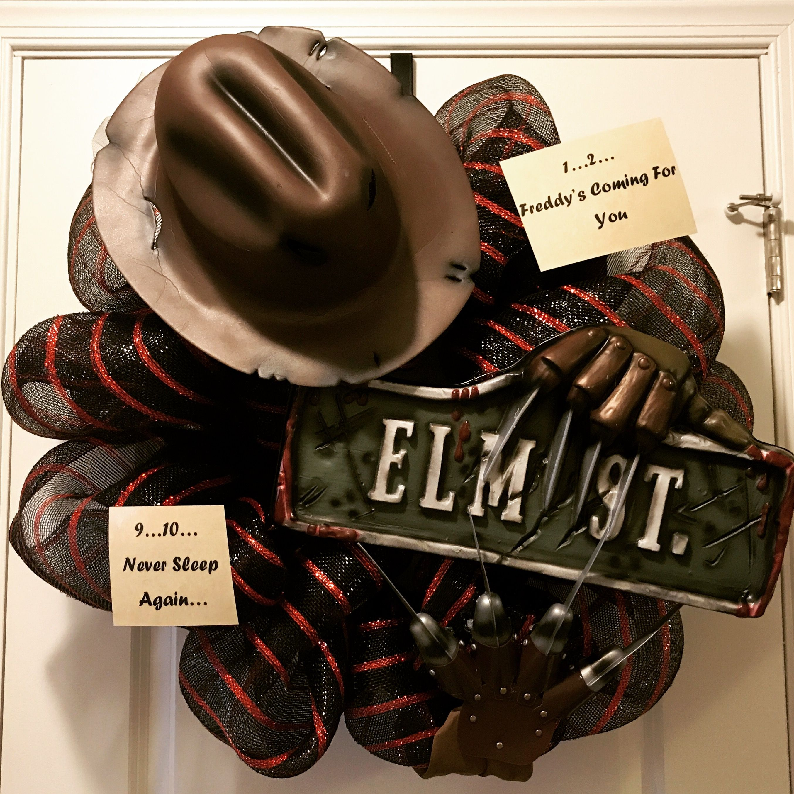 hand made freddy krueger wreath. hat, claws, and elm street sign can