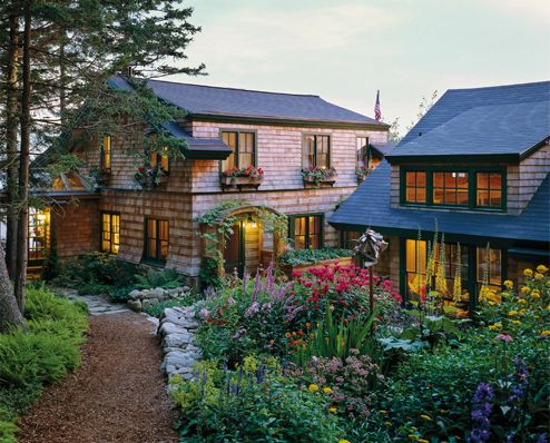 This Rustic Resort is composed of a series of cottages linked through breezeways and landscaping.