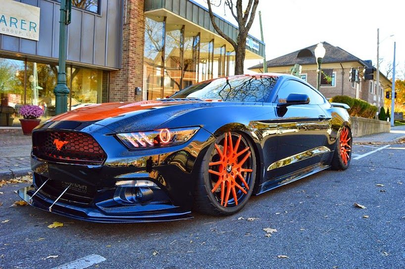 Black and orange Ford Mustang on a set of matching Forgiato Wheels