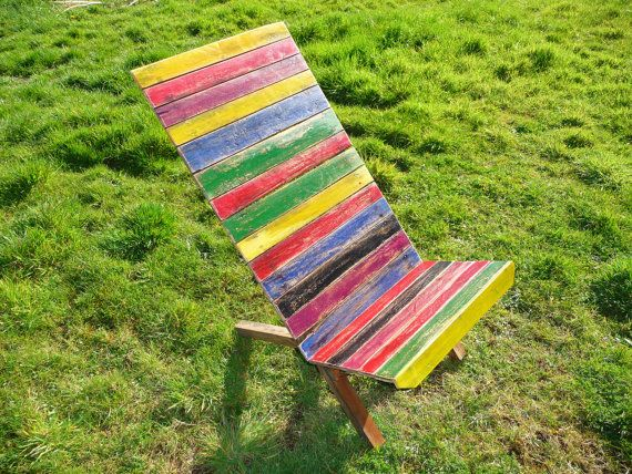 Multicoloured painted African style outdoor wooden garden chair. Retro seat with beautiful colours.