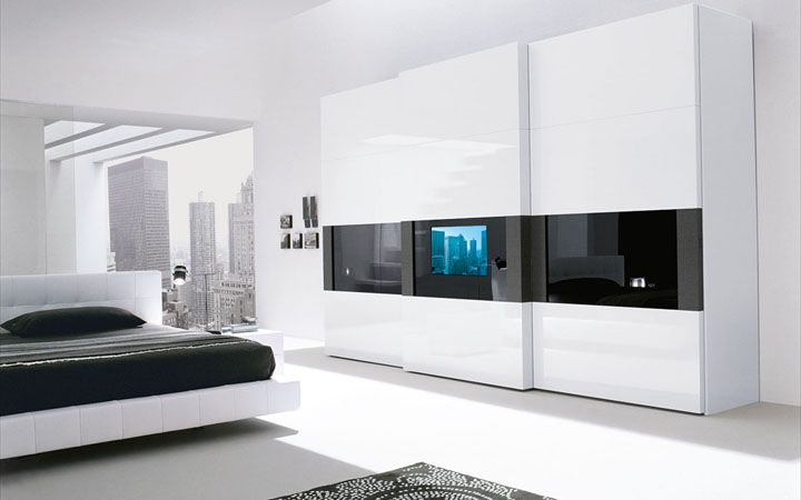 Super modern bedroom wardrobe with a tv built in the door for Bedroom ideas with built in wardrobes