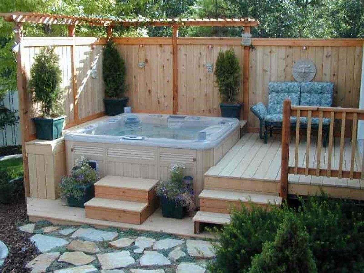 corner deck hot tub with small pergola and vertical privacy fence also outdoor - Hot Tub Design Ideas