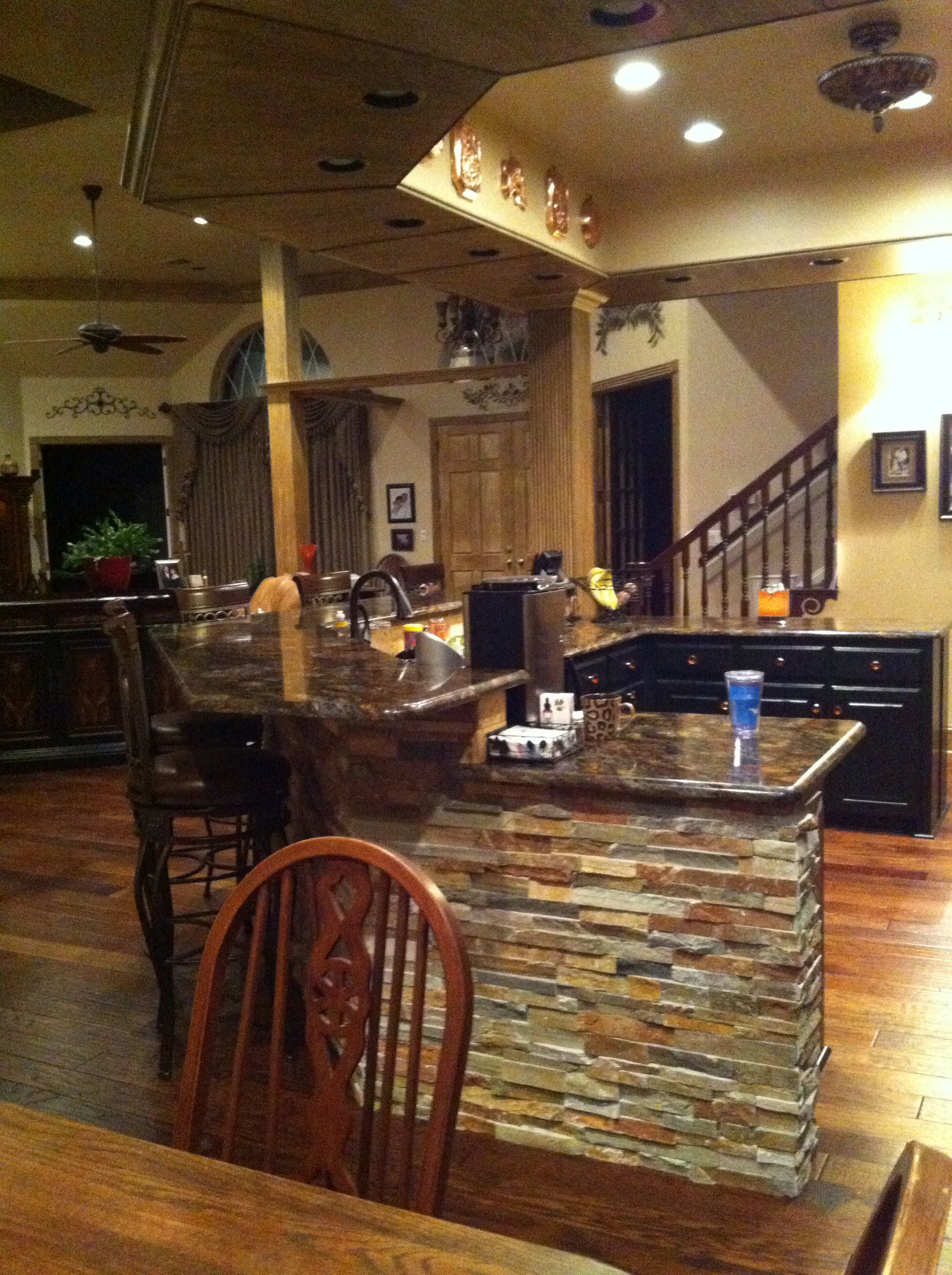 Stacked stone under bar | Stone kitchen, Stacked stone ...