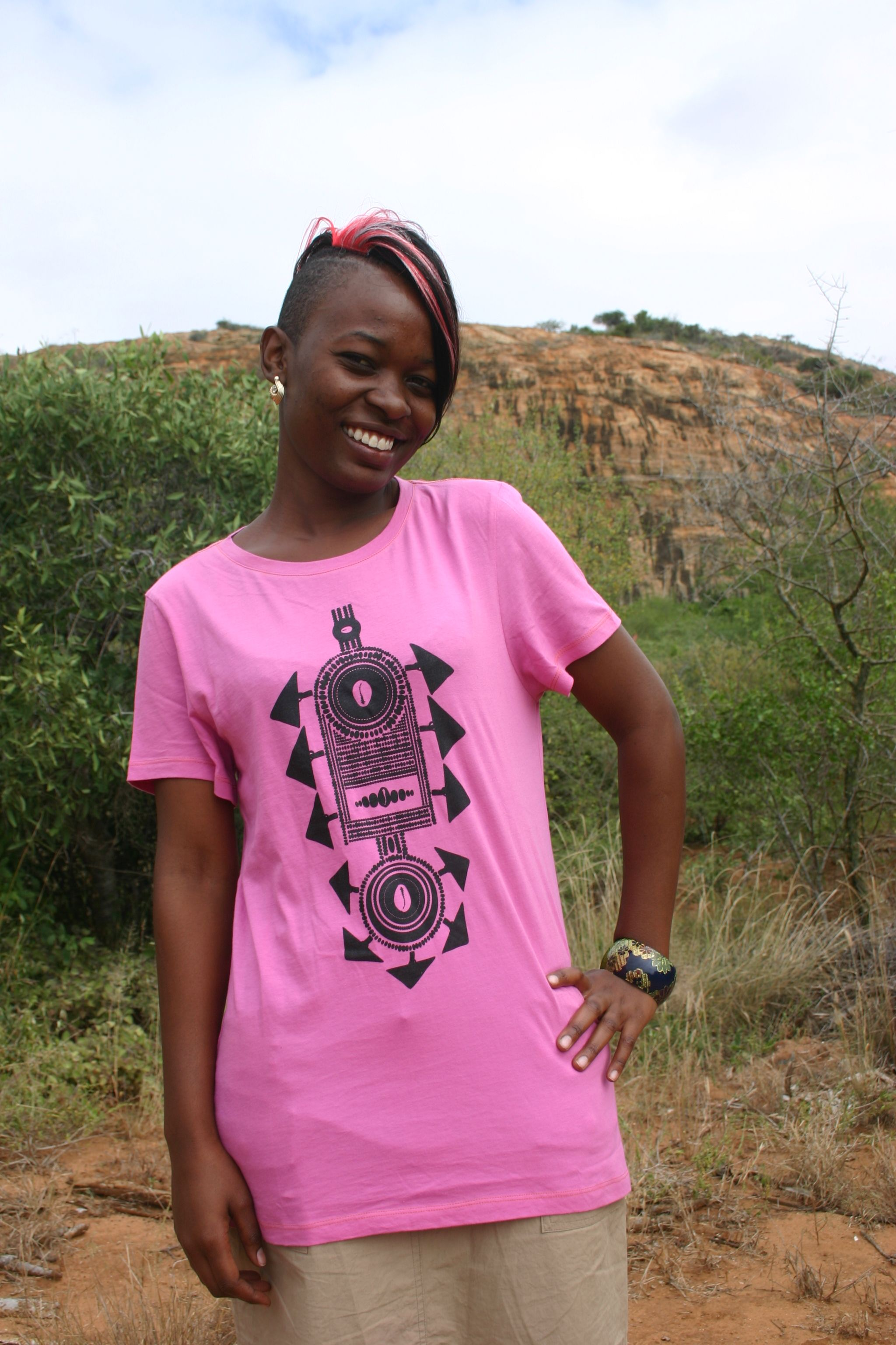 This is Naomi Wanjala, a production clerk at the Wildlife Works Factory in Kenya.  She's wearing a T4T tee, one of many styles we now produce there!