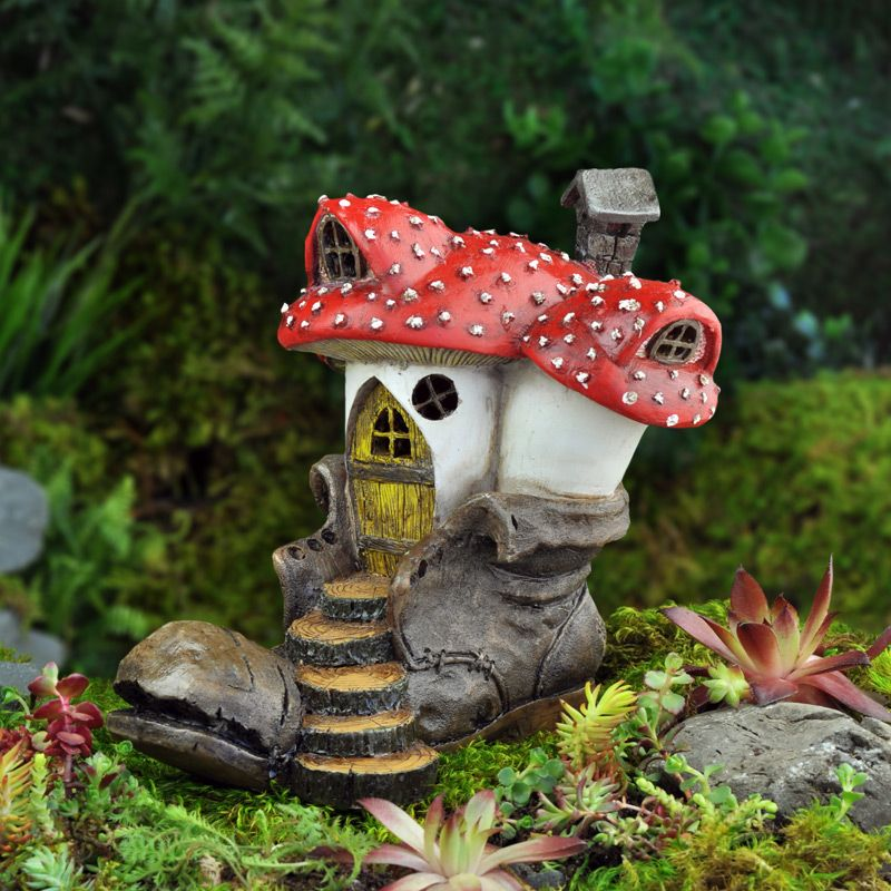 A Fairy House Made Out Of An Old Brown Leather Cloddhopper Boot Left Behind  From Hiking Humans And Large Forest Mushrooms.