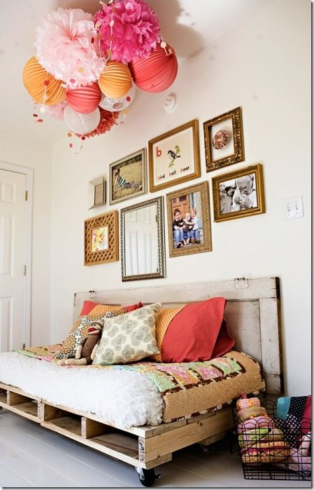love the pom pon and tissue flower ceiling decoration