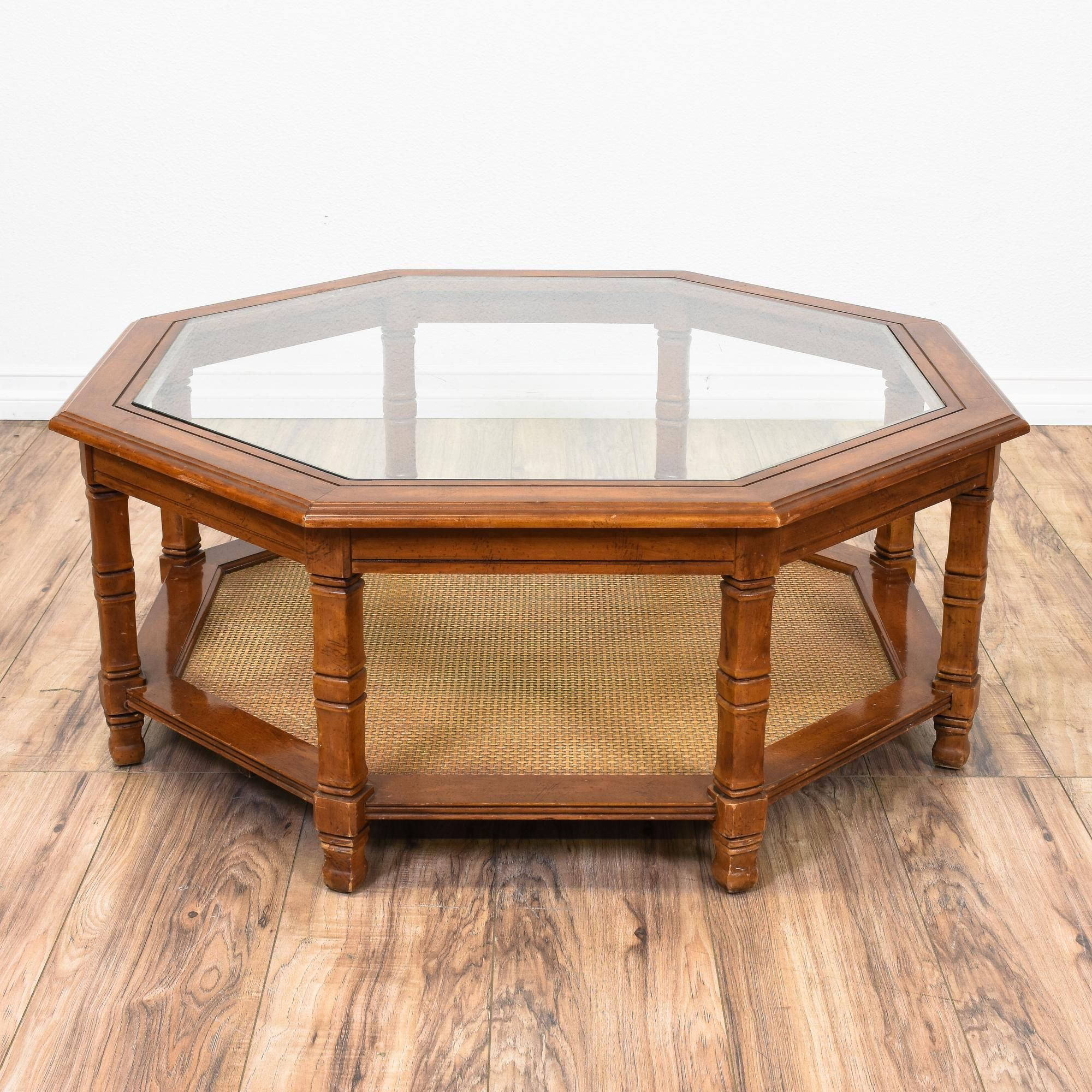 This octagon coffee table is featured in a solid wood with for Octagon glass top coffee table