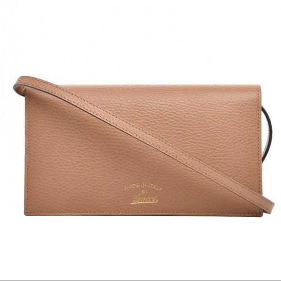 0fe2402cb29 Gucci Women s Cameilia Beige Wallet Crossbody -Camelia Beige with a light  blue interior. -