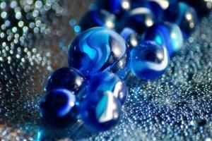 Marbles in Blue Rolling by Hercio Dias