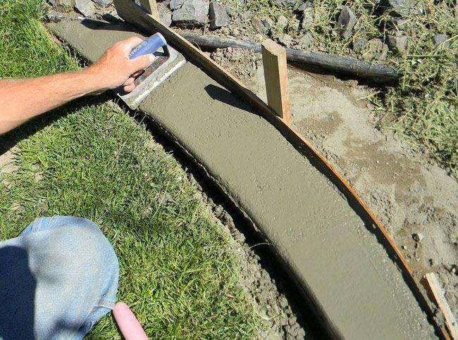 17 awesome diy concrete garden projects concrete edging for Homemade garden edging ideas