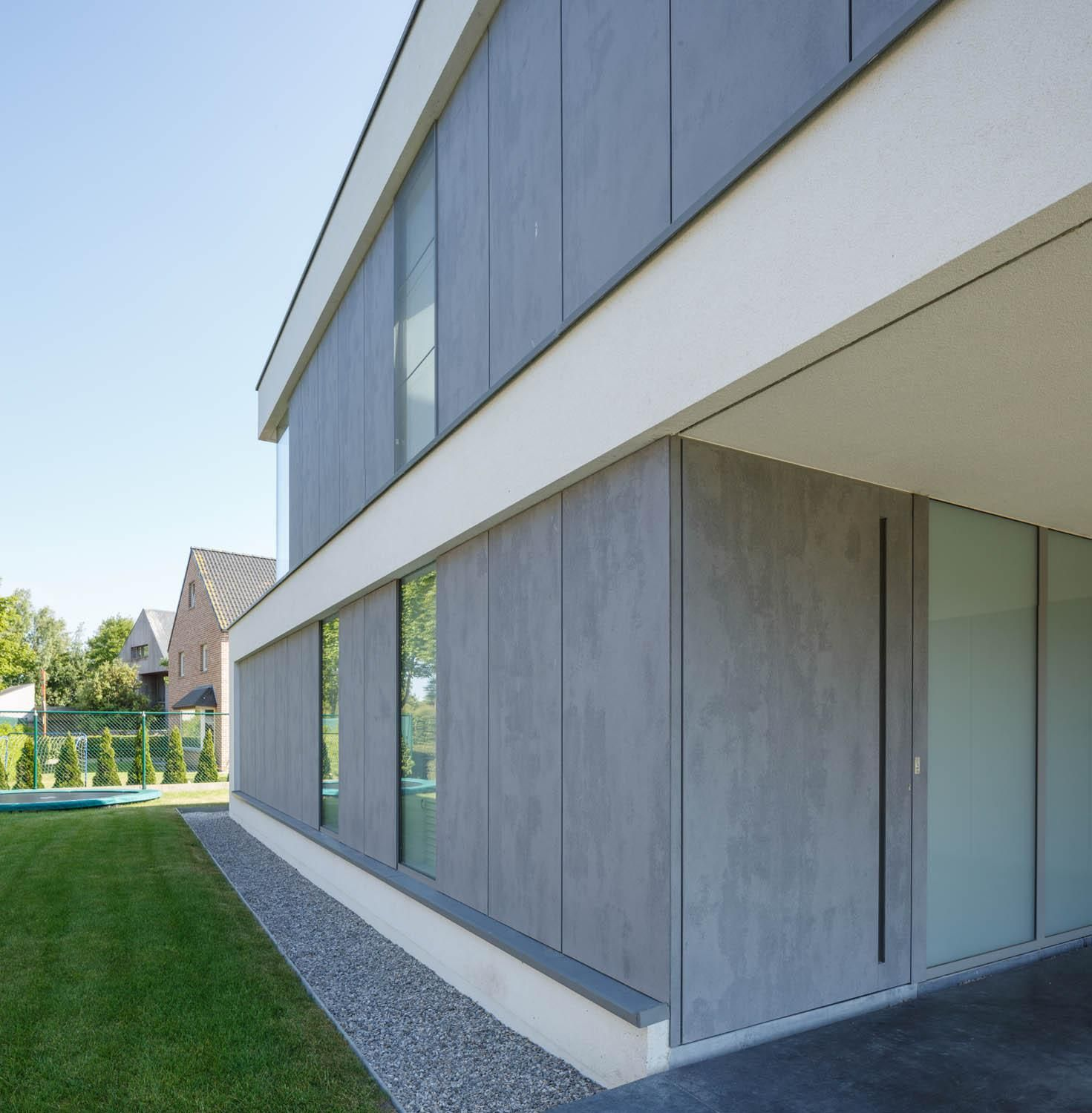 Modern Home Idea : Front Door Cleverly Concealed In Facade Structure.  EQUITONE Facade Panels.