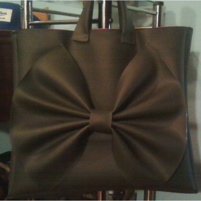 Love a big bag with a bow! Designs by Amira Williams-Estell
