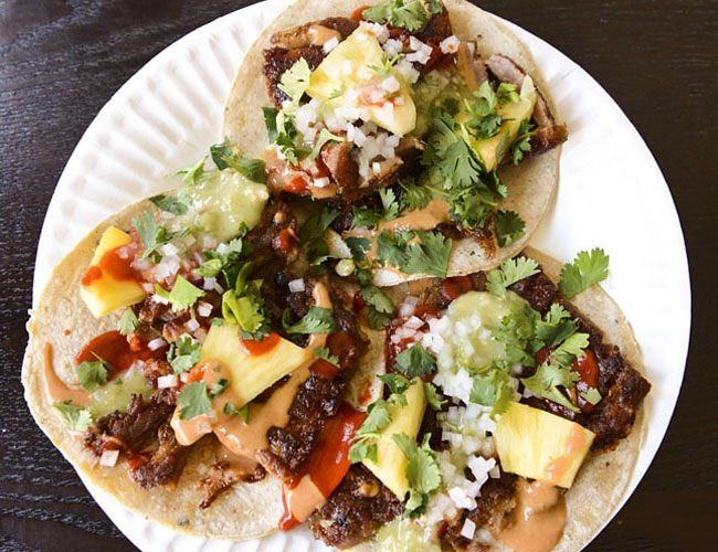 Mexican cuisine should be celebratedand more importantly consumedevery day of the year. However if you're celebrating Cinco de Mayo ditch the chain-restaurant Tex-Mex monstrosities for something like tacos from @empellon Al Pastor. #FEASTAGRAM (Photo: @liz01) by @firstwefeast