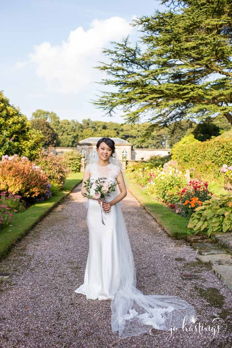 Wedding at heath house bride in gardens with her bridal bouquet by
