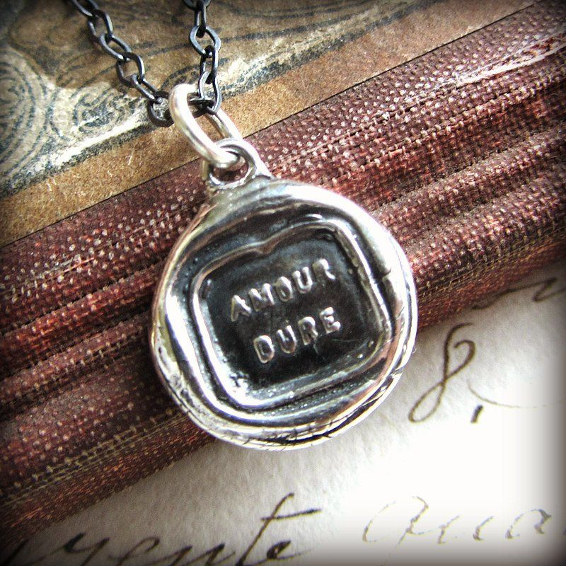 """Amour Dure. Our love will endure. What a beautiful statement this French Wax Seal pendant makes ~ English translation is """"Love Lasts"""". (Our) Love lasts forever. The perfect love token!"""