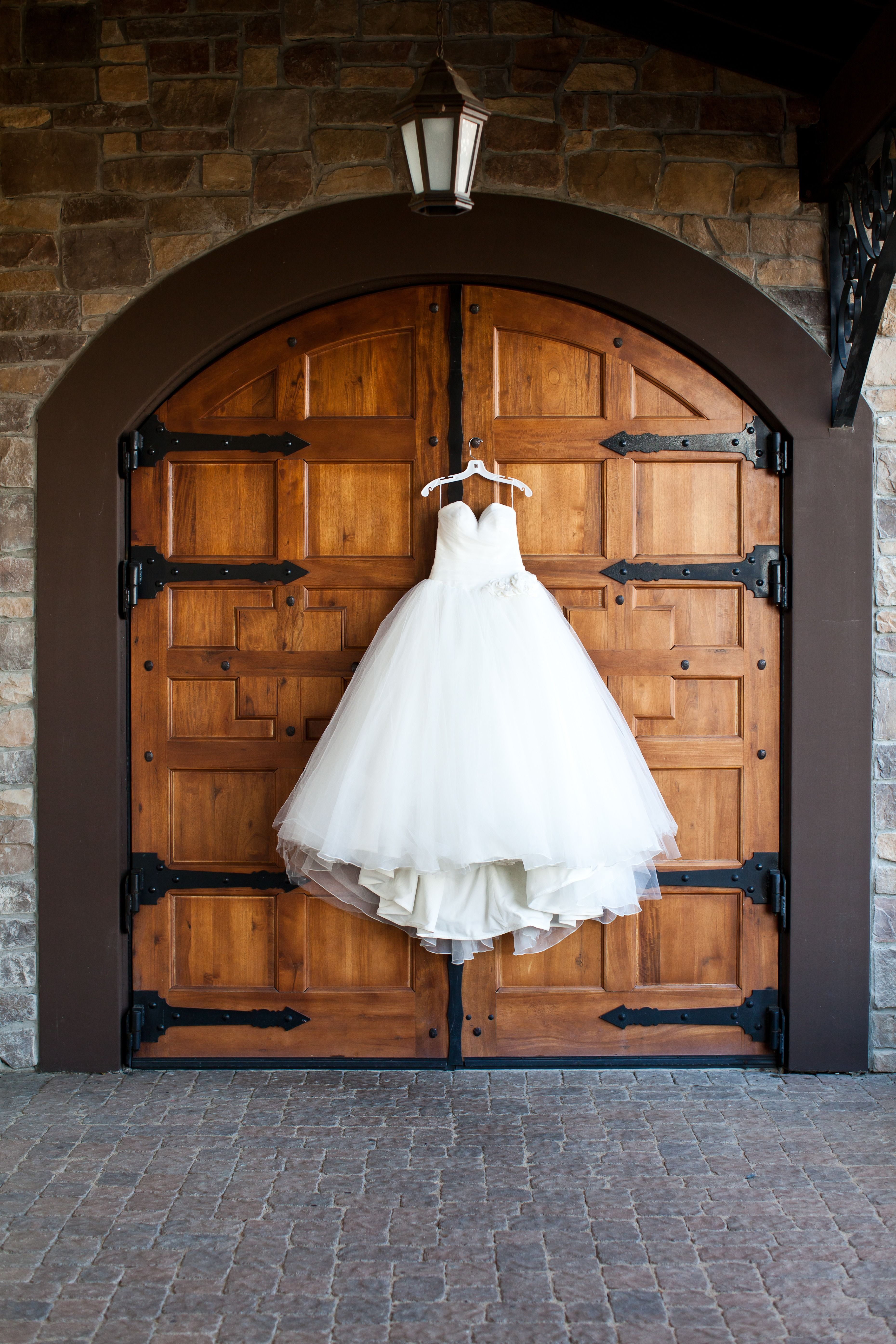A beautiful tulle ball gown was the brides second look. {Photo by Bustle & Twine}