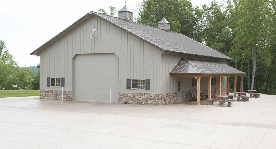 This garage was built for butch of belews creek nc for Metal garage with porch