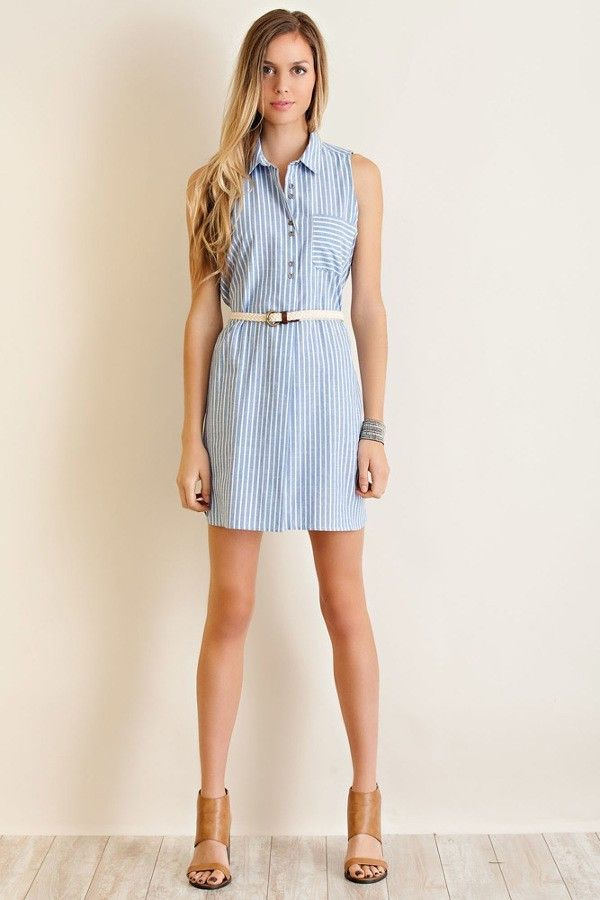 a8c3e3645bd827 Get perfectly preppy in this blue and white striped, sleeveless, belted, shirt  dress. A-line cut, collared button down with a cute pocket on top.