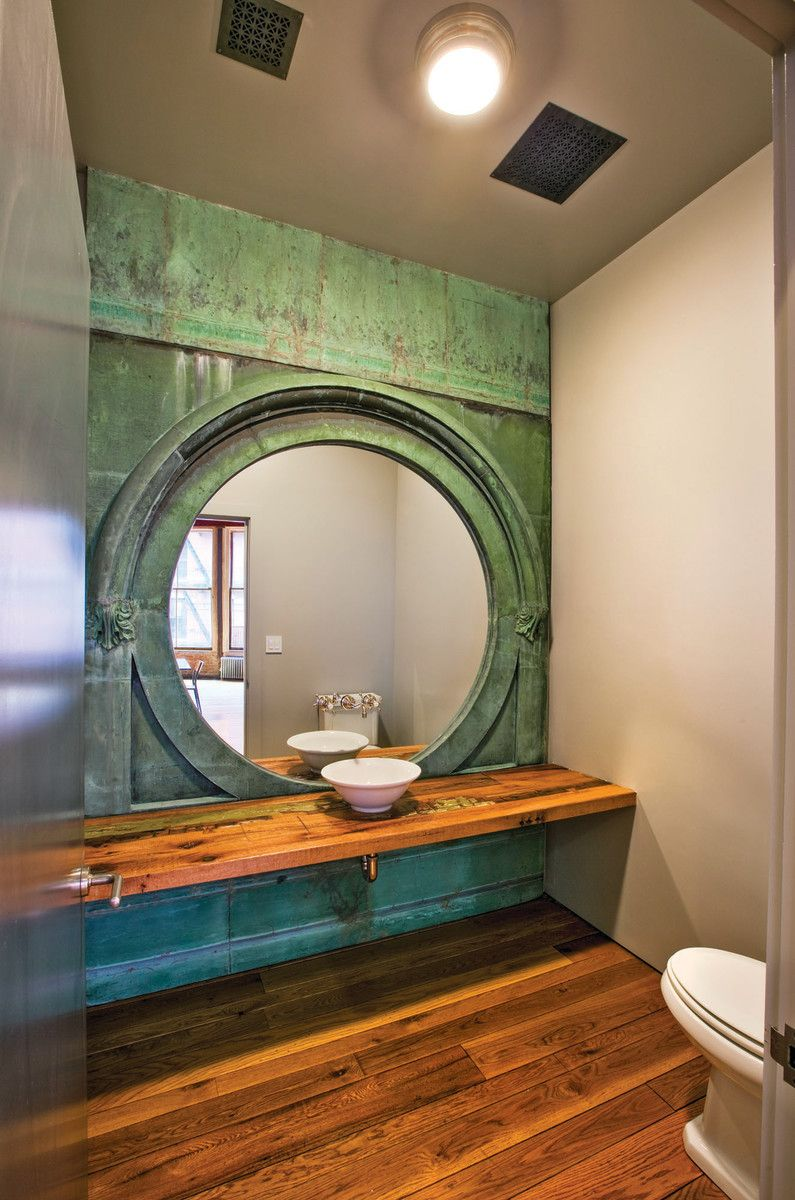 A copper window assembly creates a stunning powder room.