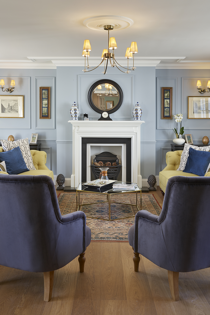 Traditional Style Living Room In Shades Of Blue And Yellow With