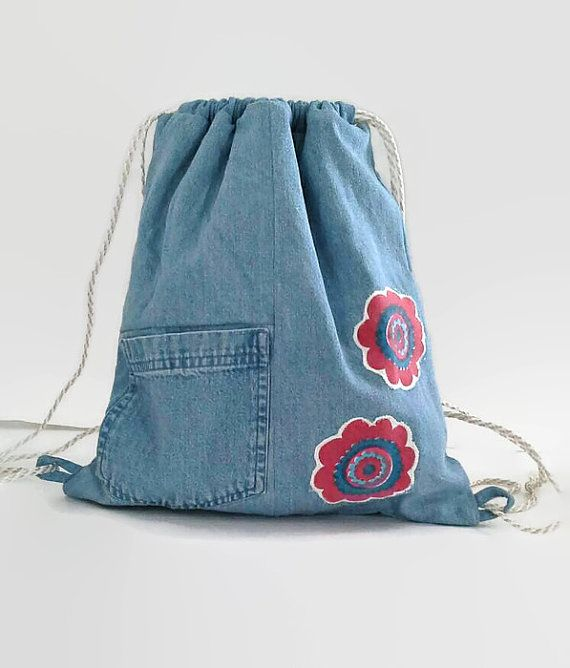 Denim with Appliqued Red Flowers Upcycled by debupcycles on Etsy