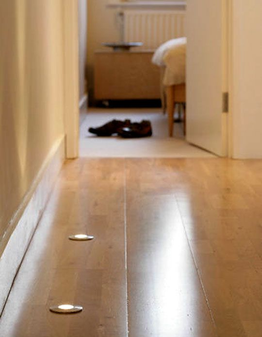 in floor lighting fixtures. recess small lights like the ones you install under upper cabinets in kitchen into floor of a dark hallway better than turning on super bright lighting fixtures