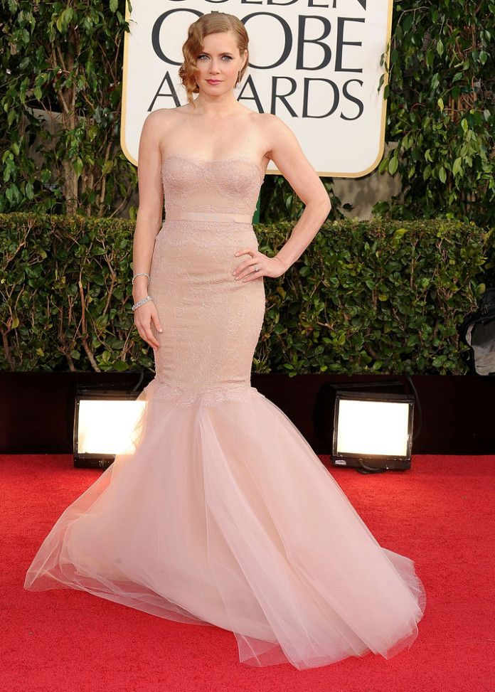 Nominated for her role in The Master, Amy Adams was the master of the red carpet in 2013 in this Marchesa tulle gown. Tiffany & Co. jewels made this one of our favorite looks ever. Check out which stars made our TOP 10 looks from the last 10 years and build your own Red Carpet closet at www.BattleShop.co!