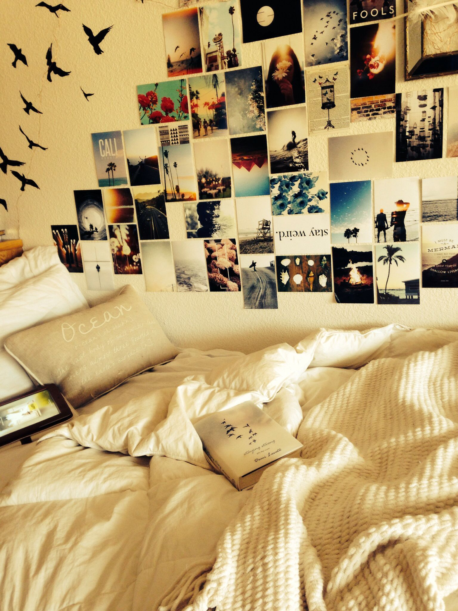 Cute and cozy college dorm room. Love the pictures on the wall ...