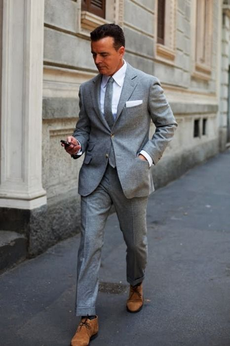 Grey suit, white pocket square, tan shoes. A perennial winner.