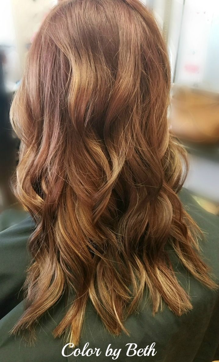 All over Goldwell copper brown color with cubtle blonde balayage