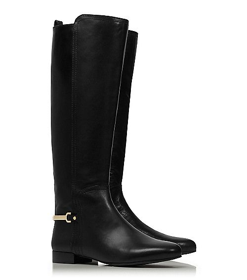 """This streamlined equestrian style features a slender gold metal band at the heel, detailed with a signature logo."""