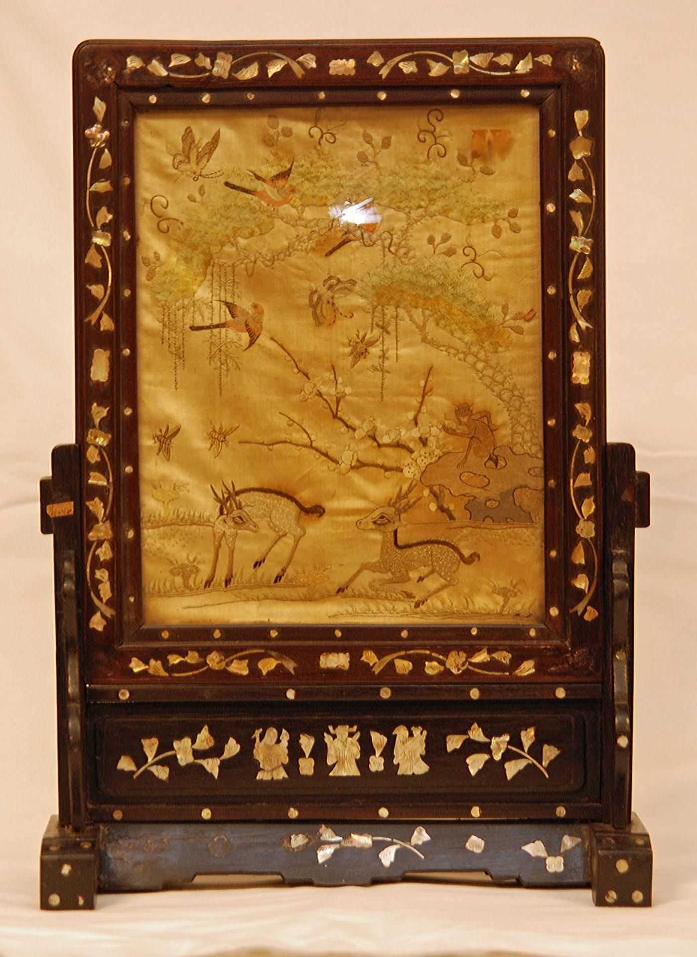 antique chinese hand embroidered silk screen depicting deer monkey butterflies insects flowers trees and paradise birds mounted in wooden table screen