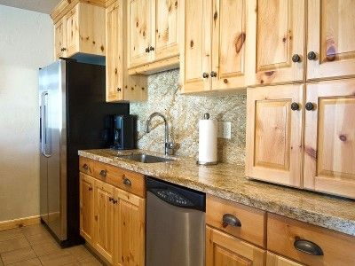 Quartz Countertops With Pine Cabinets