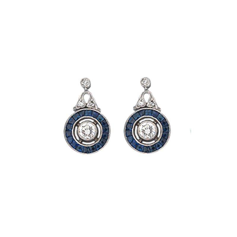 A vintage pair of round sapphire and diamond cluster earrings with diamond scroll tops.
