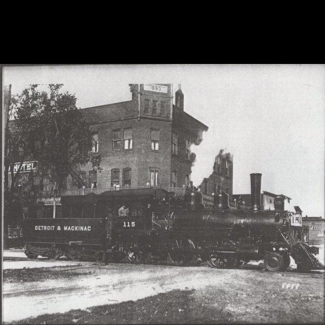 Detroit And Mackinac Steam Locomotive In Front Of The Former Holland Hotel East Tawas Michigan