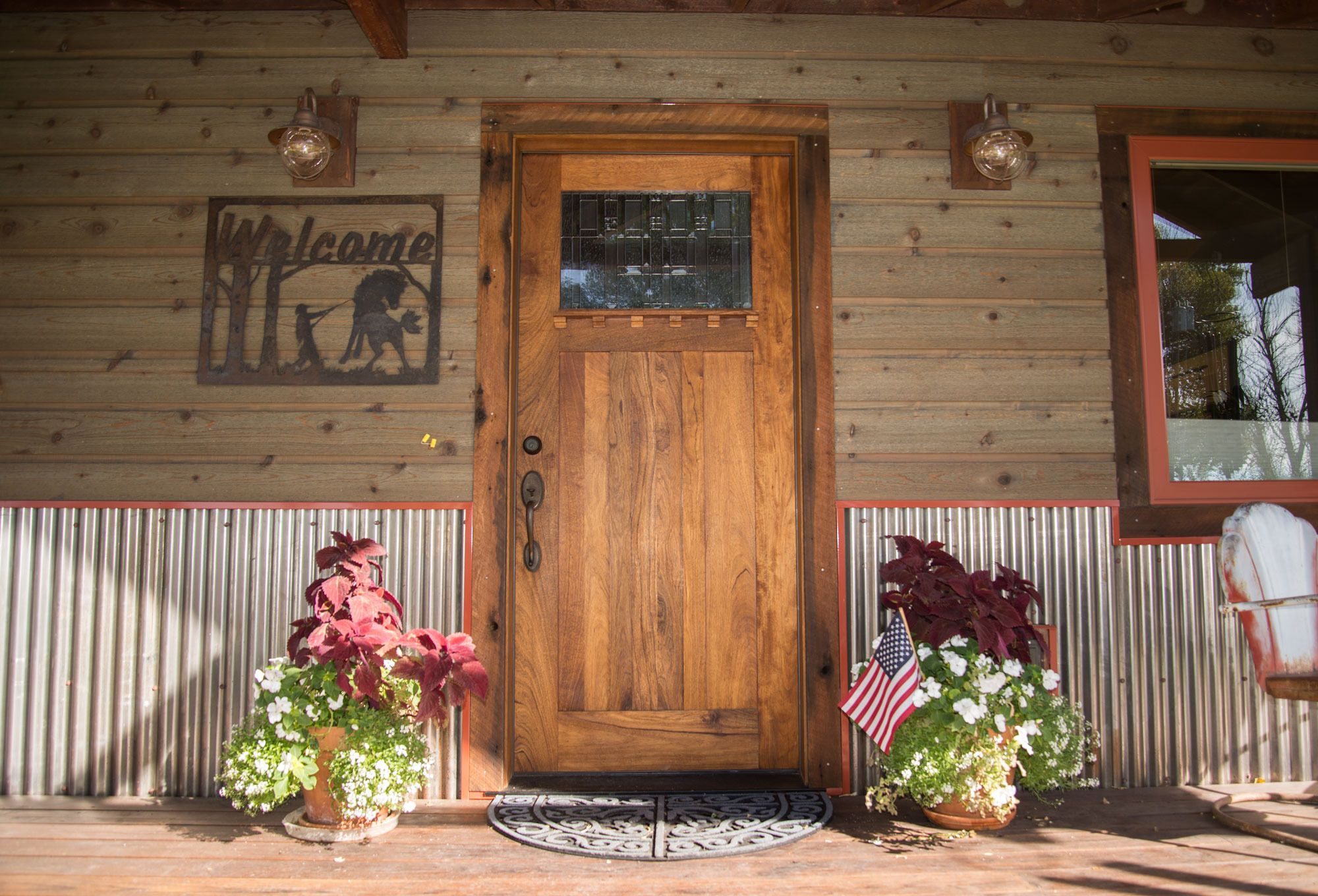 Welcoming front entry accented with bridger steel for Rustic siding ideas