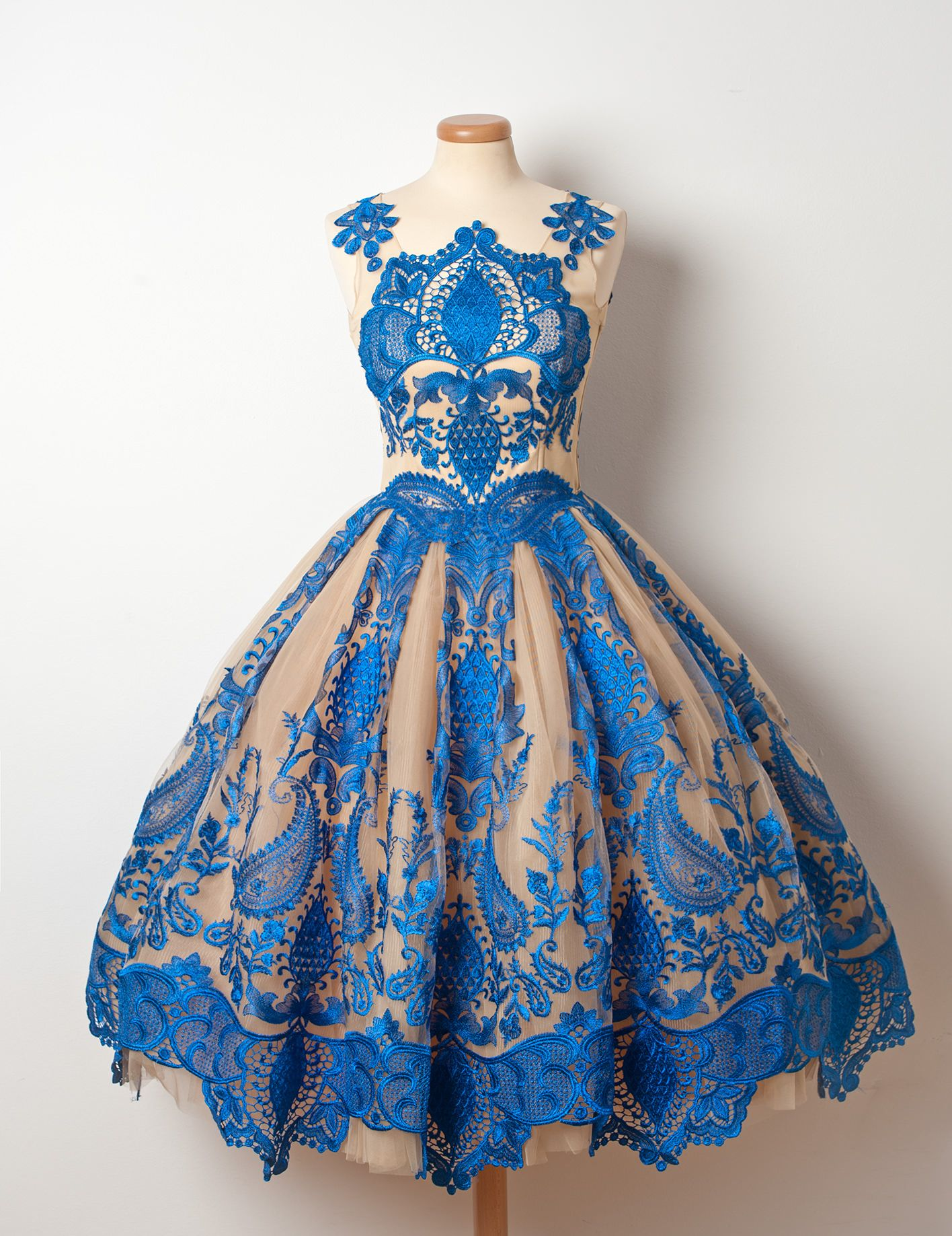 A sweet u sour fancy dessert with extravagant blue lace topping add