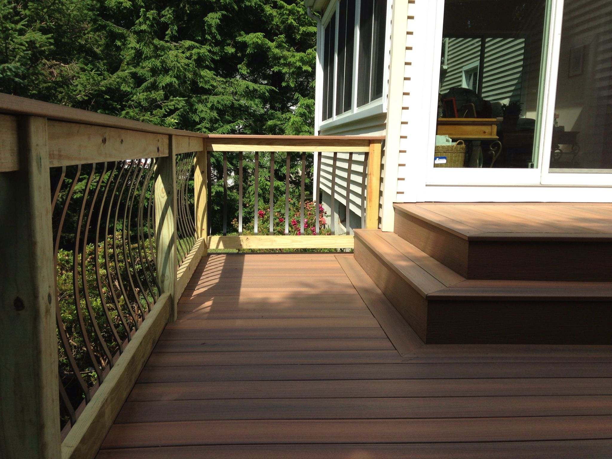 Composite decking with pressure treated railings for Composite decking and railing