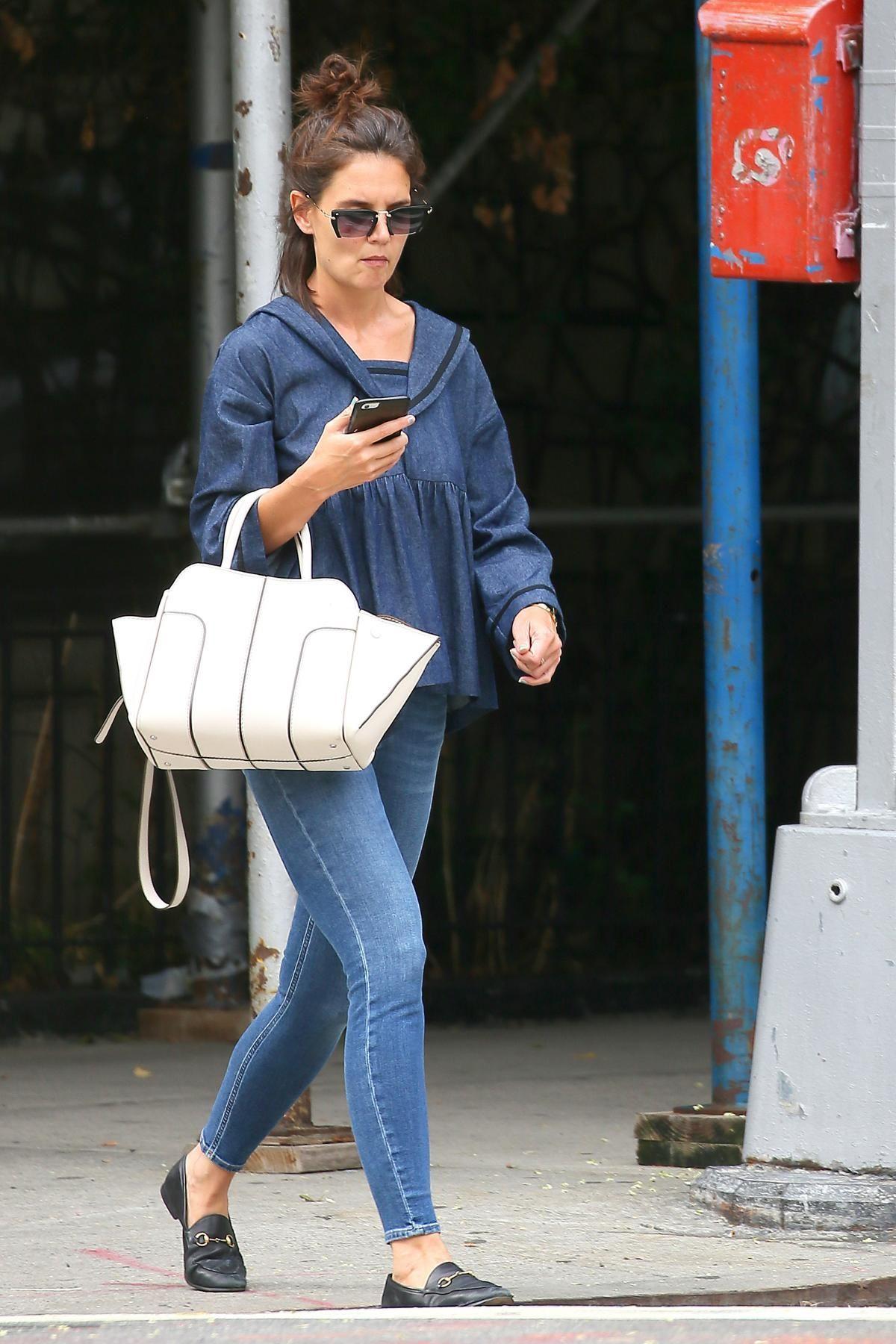 428910c3ec7 Katie Holmes wearing Miu Miu Mu 10qs Sunglasses, Tod s Sella Bag and Gucci  Jordaan Leather Loafers