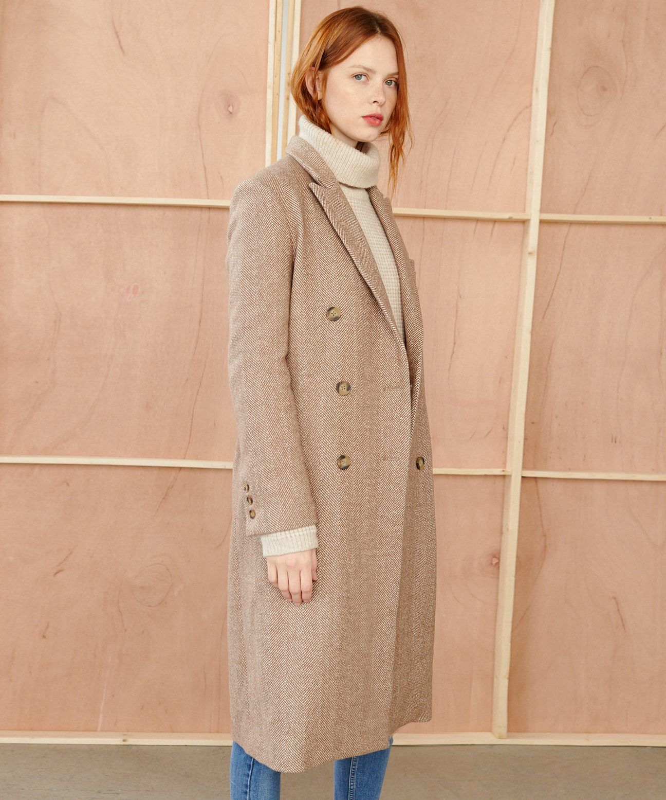 The wool herringbone coat is made of an Italian wool blend with a touch of  cashmere. With an oversized f348a031f82
