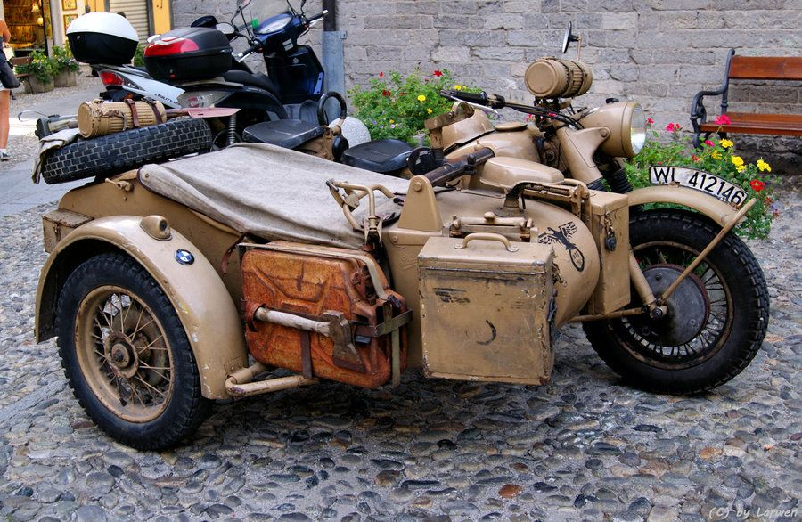 old military motorcycle with sidecar. is that a bmw symbol on the