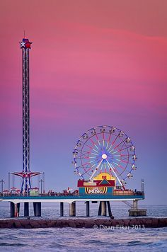 The Galveston, Texas Pleasure Pier at dusk.