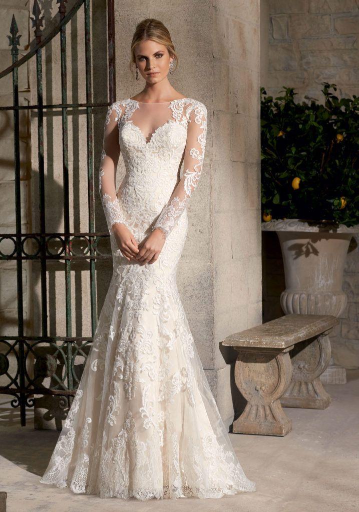 This stunning sheath wedding dress features full-length illusion ...