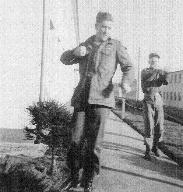 """Elvis and Lawrence O'Brien are pictured  doing some physical exercises at Ray Barracks in Friedberg, Germany - 1959. This photo is in the book """"Elvis: Like Any Other Soldier (The Pictorial History of Elvis Presley's Army Years: 1957-1960)"""", Hardcover - 2010, by Jerry Osborne & Barbara Hahn (Authors). Take a look inside : https://www.youtube.com/watch?v=FlbuDCUH2dw"""