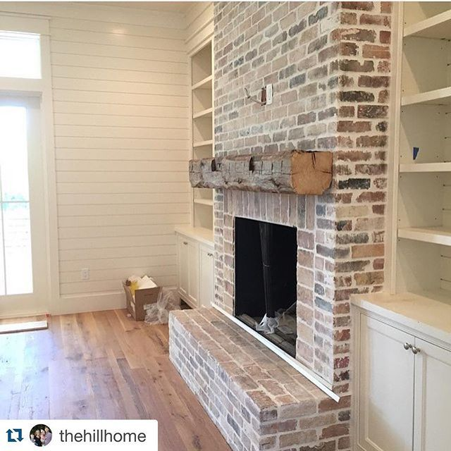 I am in love with this picture! I want that exact brick everywhere in my house. The fireplace, kitchen backsplash, laundry room. The walls are amazing too. thanks for sharing it on your feed @thehillhome. We can both dream. (I don't have a bricked fireplace , so I can't even whitewash anything.) #brickfireplace #oldbrick #shiplap