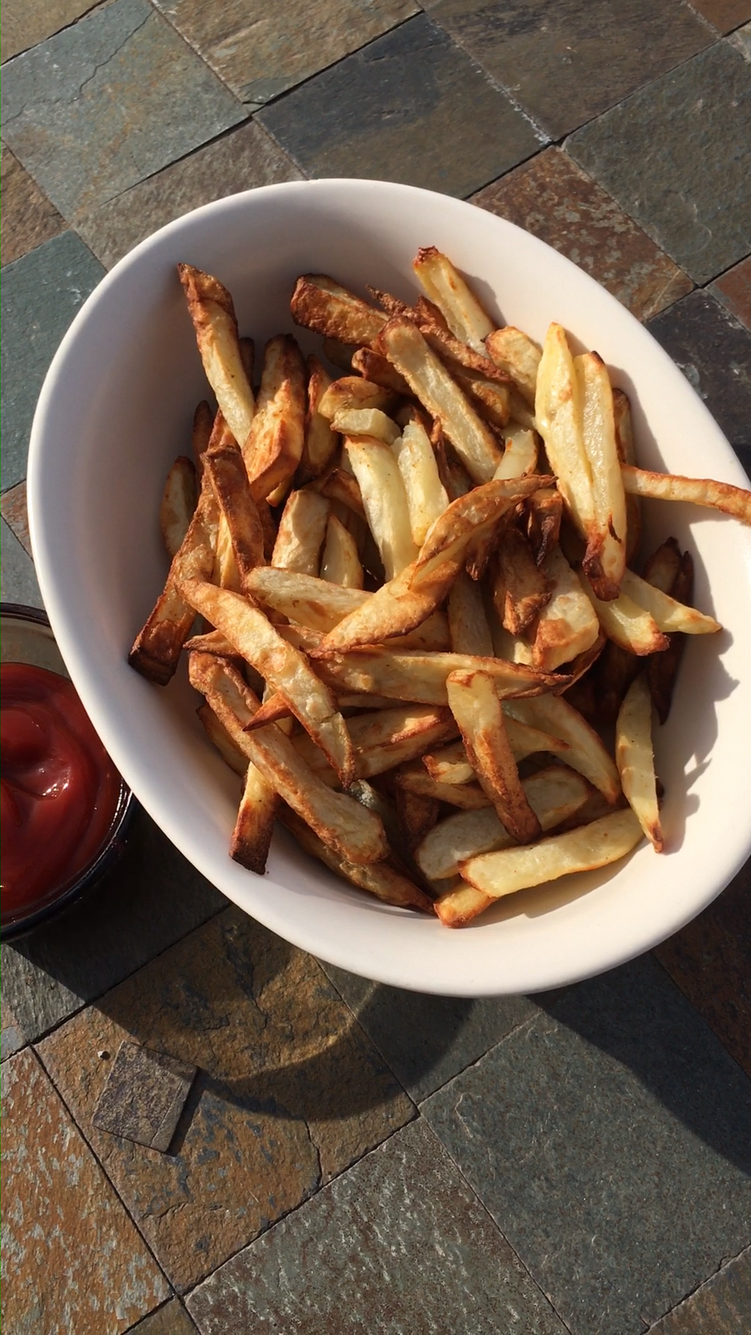 This is a simple 4 ingredient recipe to make easy air fryer French fries using only 2 teaspoons of c...