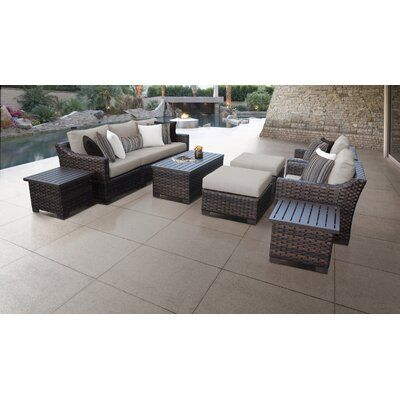 kathy ireland Homes & Gardens by TK Classics River Brook 10 Piece Rattan Sectional Seating Group with Cushions Cushion Color: Almond
