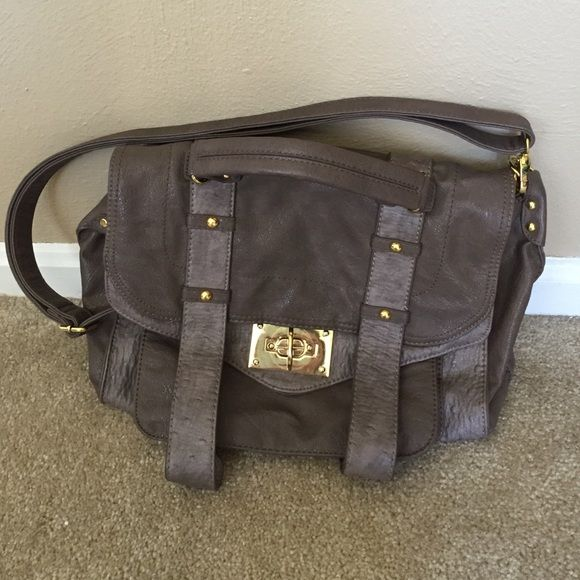 Steve Madden purse only used for a couple days. Steve Madden over the shoulder and hand bag. Multiple compartments inside including large zipper pocket, cell phone pocket, and large pocket. Another big pocket under the buckle and zipper pocket on back. Taupe color. Resembles pricey Proenza Schouler bag. Steve Madden Bags Shoulder Bags